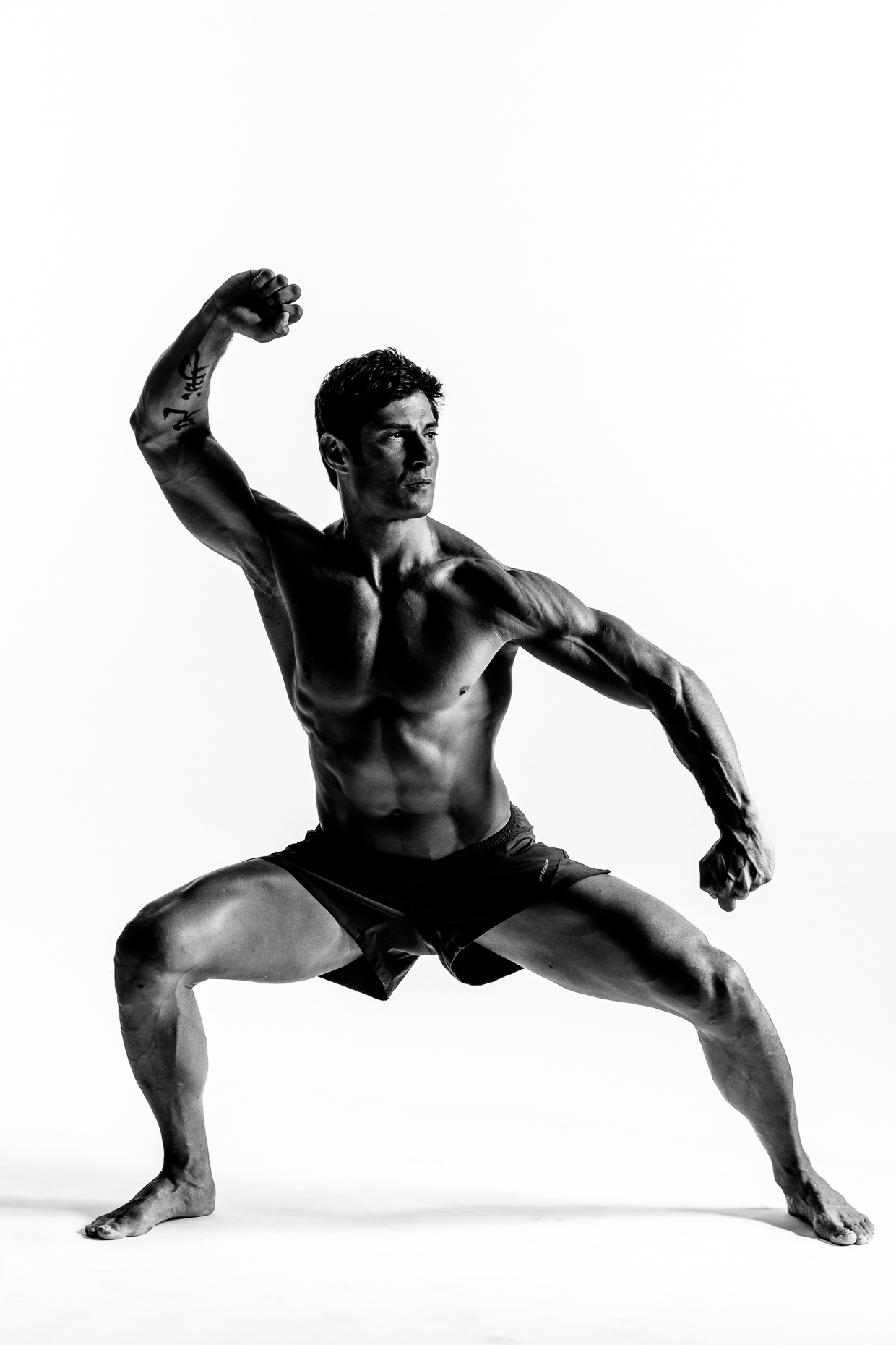 B&W on white background of Rudy Reyes martial arts instructor in warrior pose by andy batt