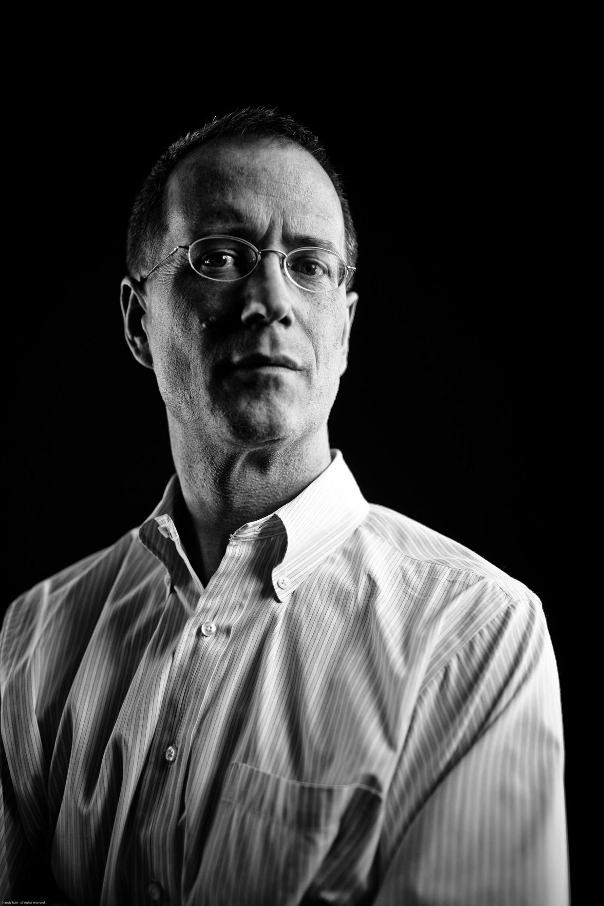 Tight B&W editorial portrait of Pulitzer Prize-winner writer Nigel Jaquiss of the Willamette Week for Portland Monthly Magazine. Photo by Andy Batt