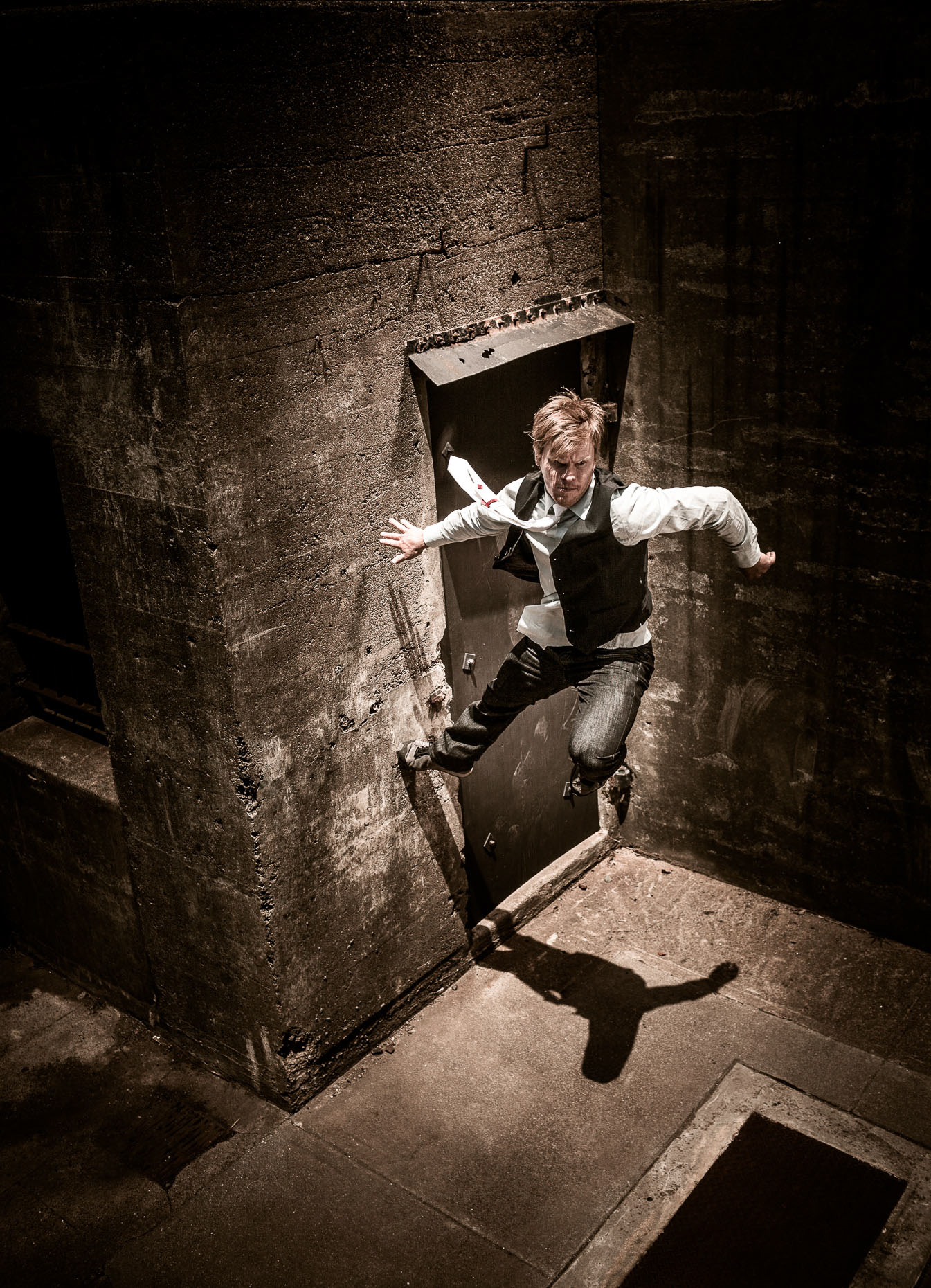 parkour freerunner athlete brian orosco jumps off wall at the Presidio army bunkers by andy batt