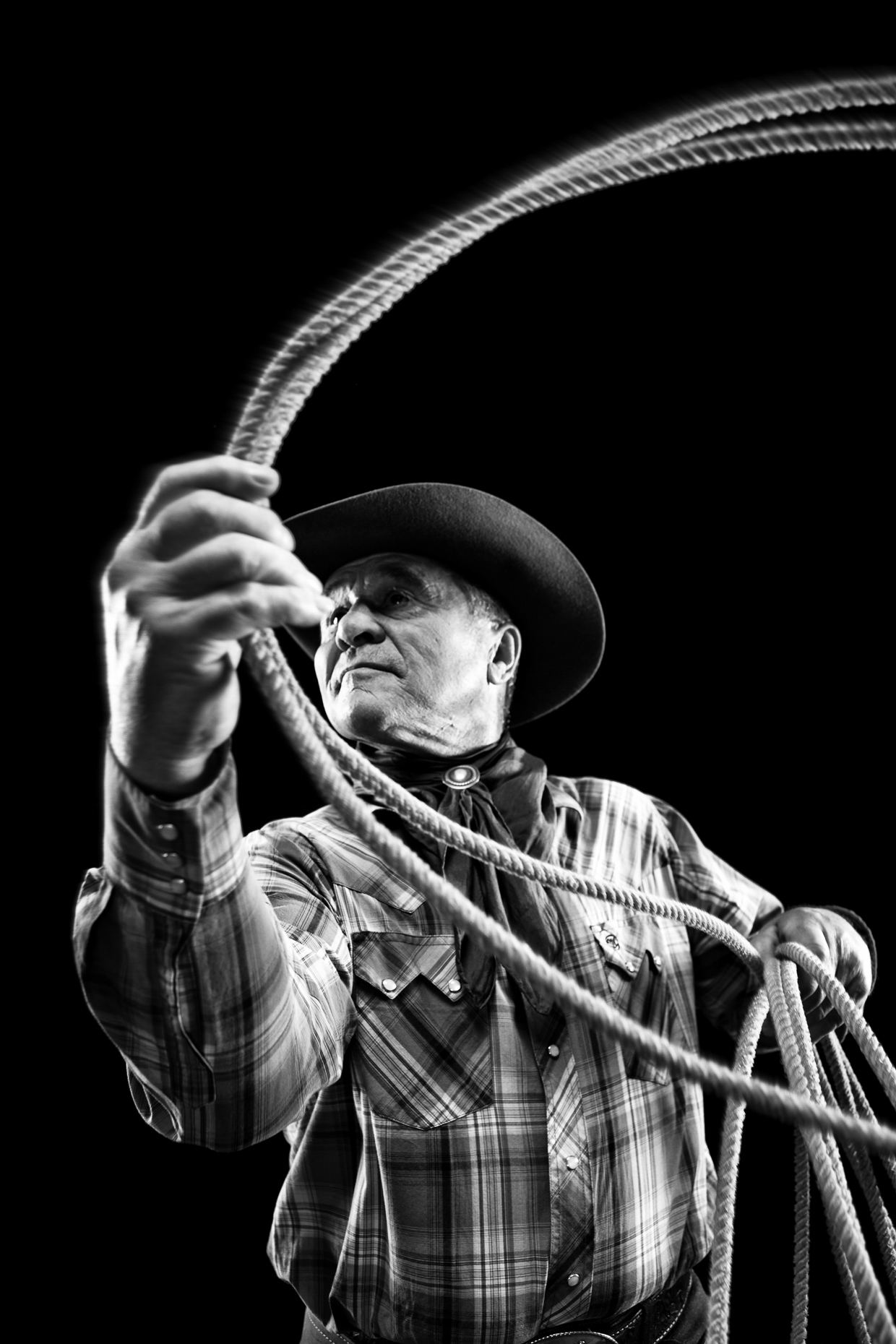 B&W portrait of Cowboy Larry Wier with lasso rope for First Interstate Bank by Andy Batt