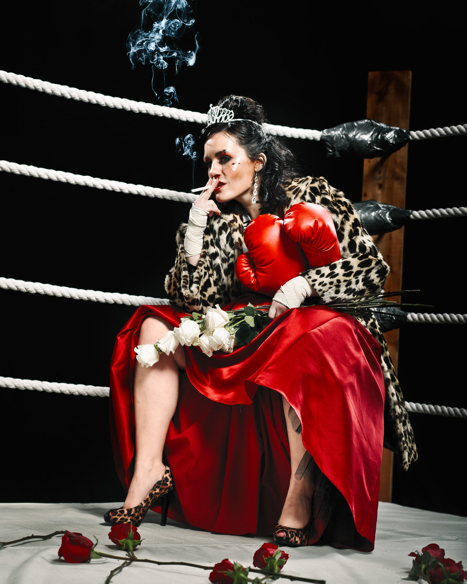 "Editorial portrait of Stacey Hallal as a beauty pagaent queen in the  ""Miss Irregardless"" boxing talent competition at the Curious Comedy Theater in Portland, Oregon. In this scene, she"