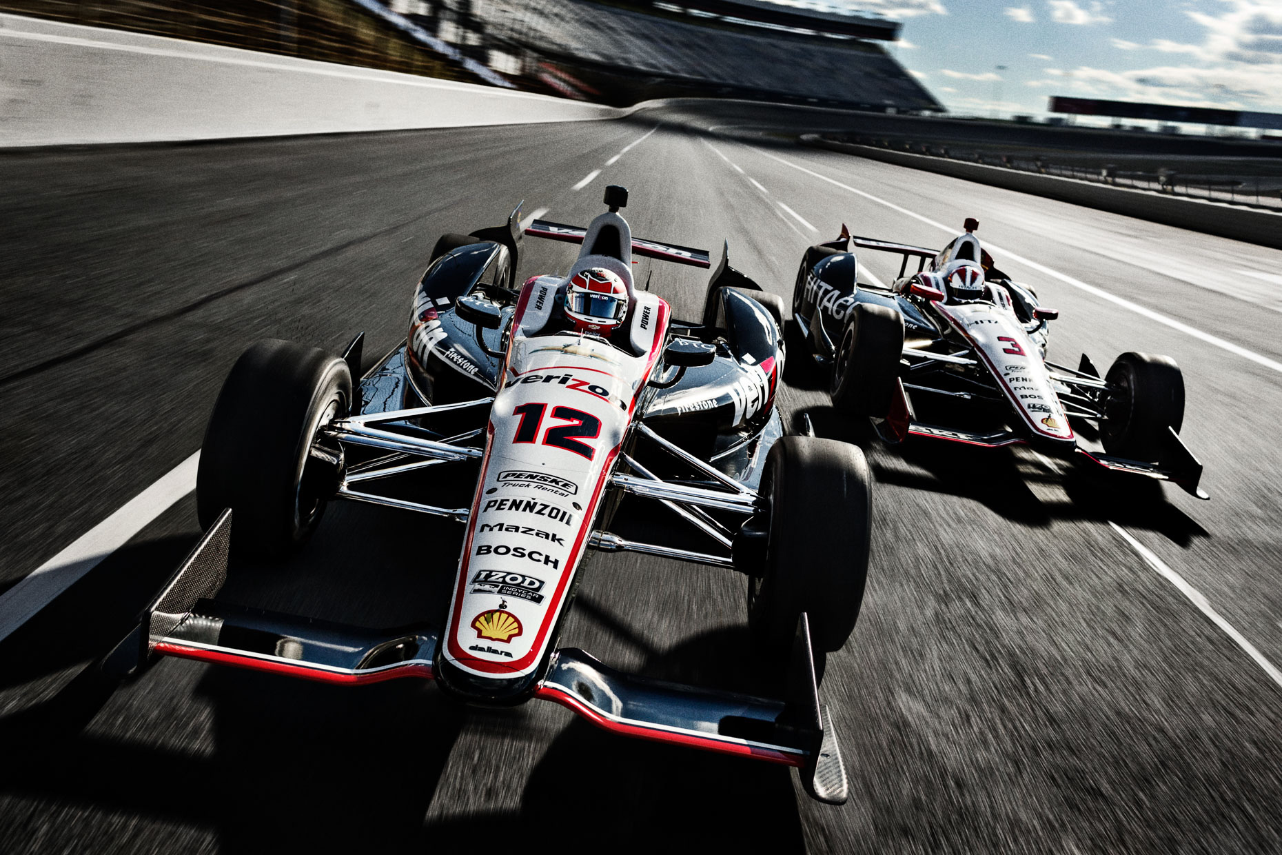 Tight shot of Indycar #12, shot from a camera chase car. Racecar drivers Will Power Helio Castroneves IndyCar Team Penske Charlotte Motor Speedway for Verizon by Andy Batt