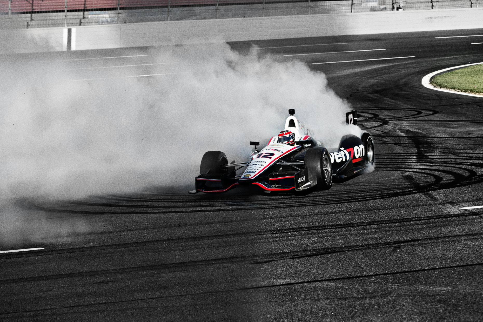 Racecar driver and athlete Will Power burns rubber and does donuts on the IndyCar Team Penske Charlotte Motor Speedway by Andy Batt