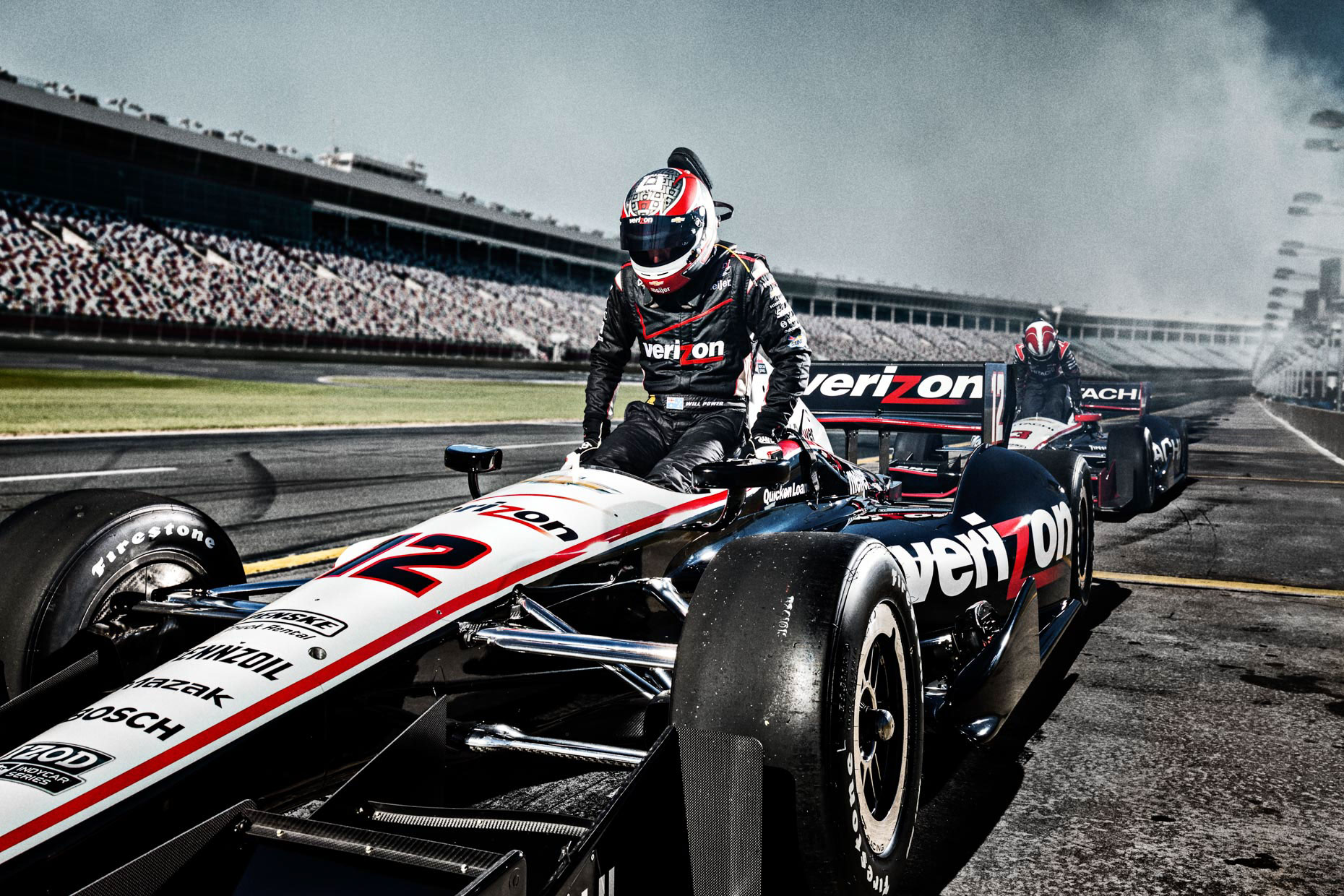 Racecar driver Will Power exits car #12 at pitstop IndyCar Team Penske Charlotte Motor Speedway by Andy Batt