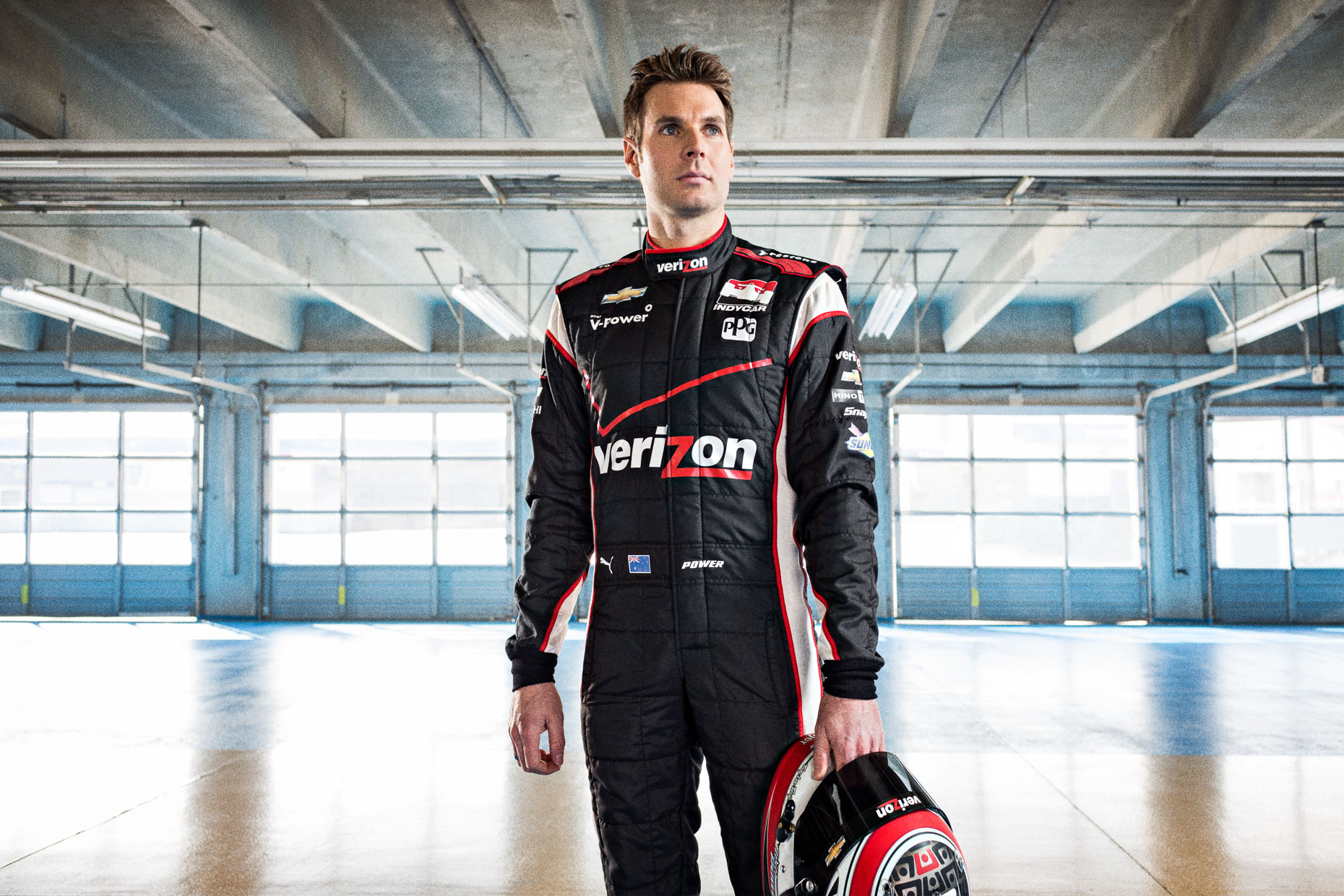 Portrait of athlete Will Power IndyCar Driver Team in the  Penske Garage at Charlotte Motor Speedway by Andy Batt