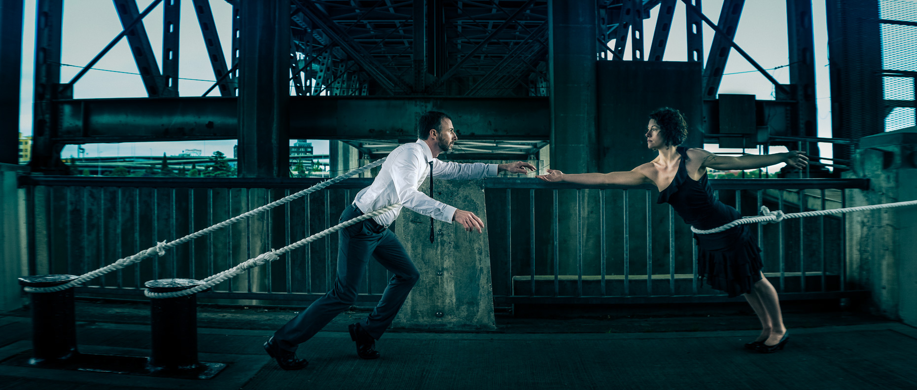 In this scene, Modern dancers Noel Plemons and Rachael Lembo practice social distance in this award-winning image under Morrison Bridge. The dancers reach towards each other, but are held back by ropes by Andy Batt