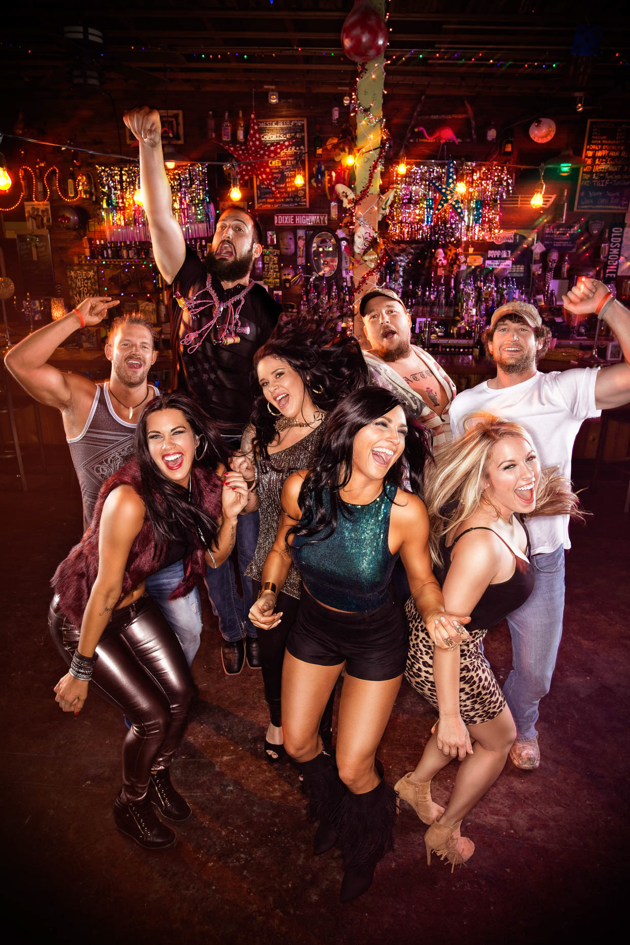 Poster art cast photo for reality TV show Party Down South, featuring Ryan Daddy Richards, Walt Windham, Josh Murray, Lyle Boudreaux,  Mattie Breax, Hannah Hott Dogg Guidry, Lauren White, and Tiffany Heinen for CMT. The cast is partying at a bar in New Orleans. Promo art gallery shoot by Andy Batt