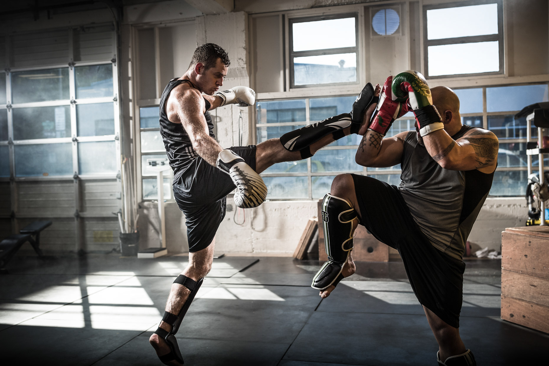MMA athletes Jose Rogriguez and Will Hatcher  training in a crossfit gym by Andy Batt
