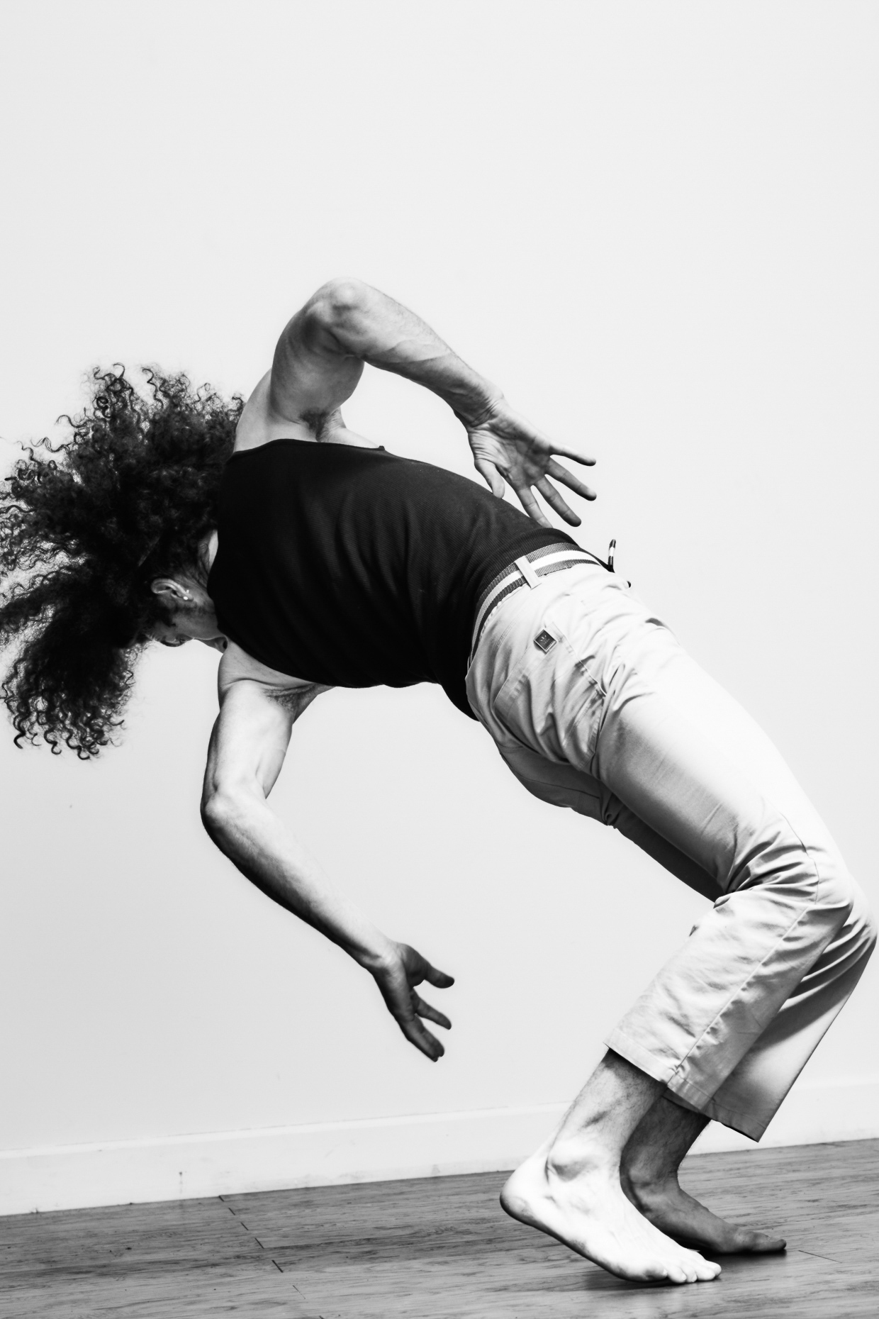 urban dancer Michael Galen break dances in a white studio by Andy Batt