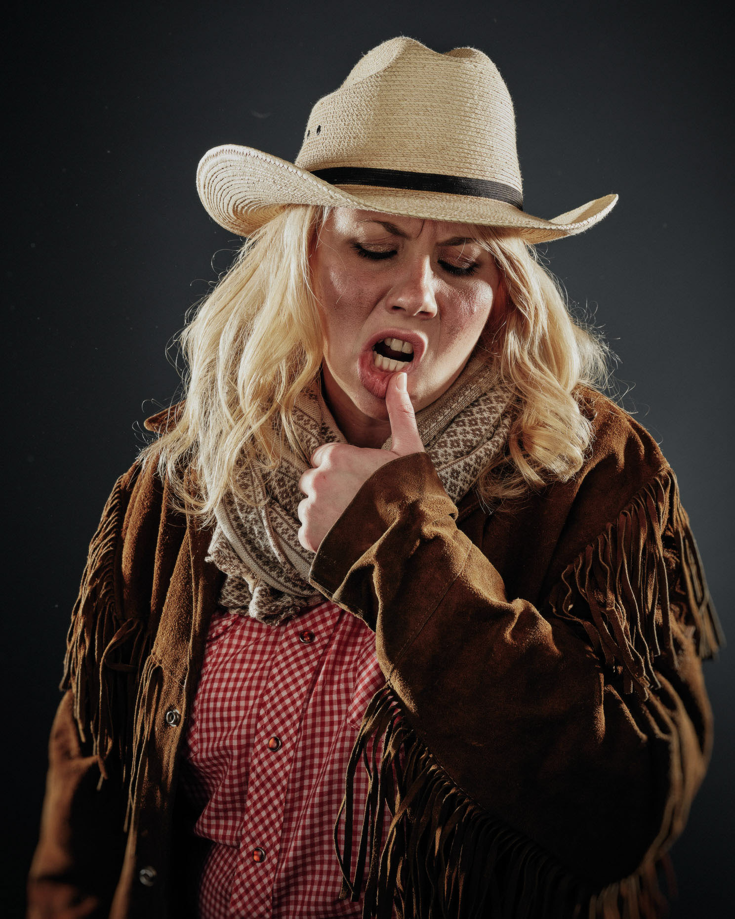 In studio character portrait of improv actor Hallie Zmroczek Curious Comedy Theater Showdown, dressed as a cowboy in a white hat. Photo by Andy Batt