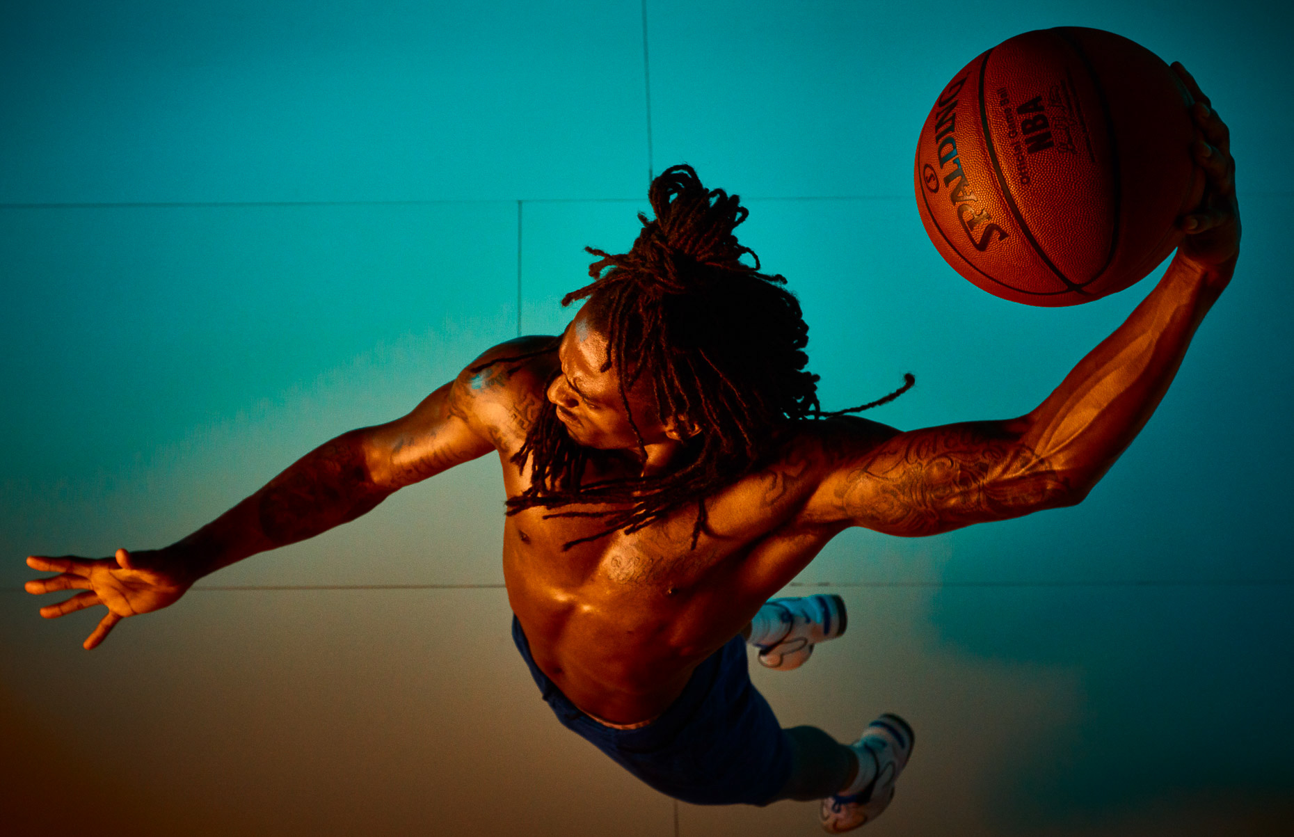 Nike basketball action shot of Xavier Taylor from overhead with colorful orange and blue gels by Andy Batt