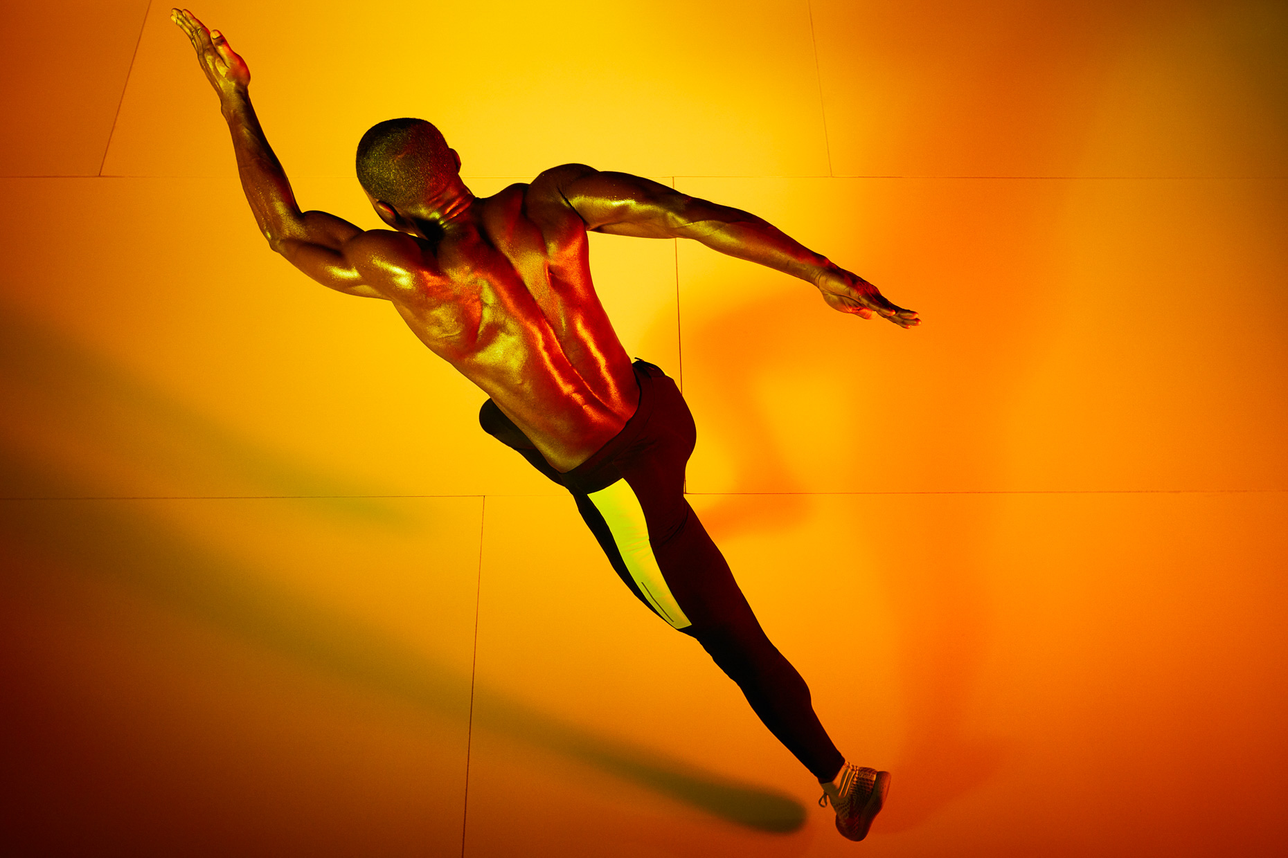 Nike Running with David Kojo Aidoo shot from above with colorful orange and yellow gels by Andy Batt