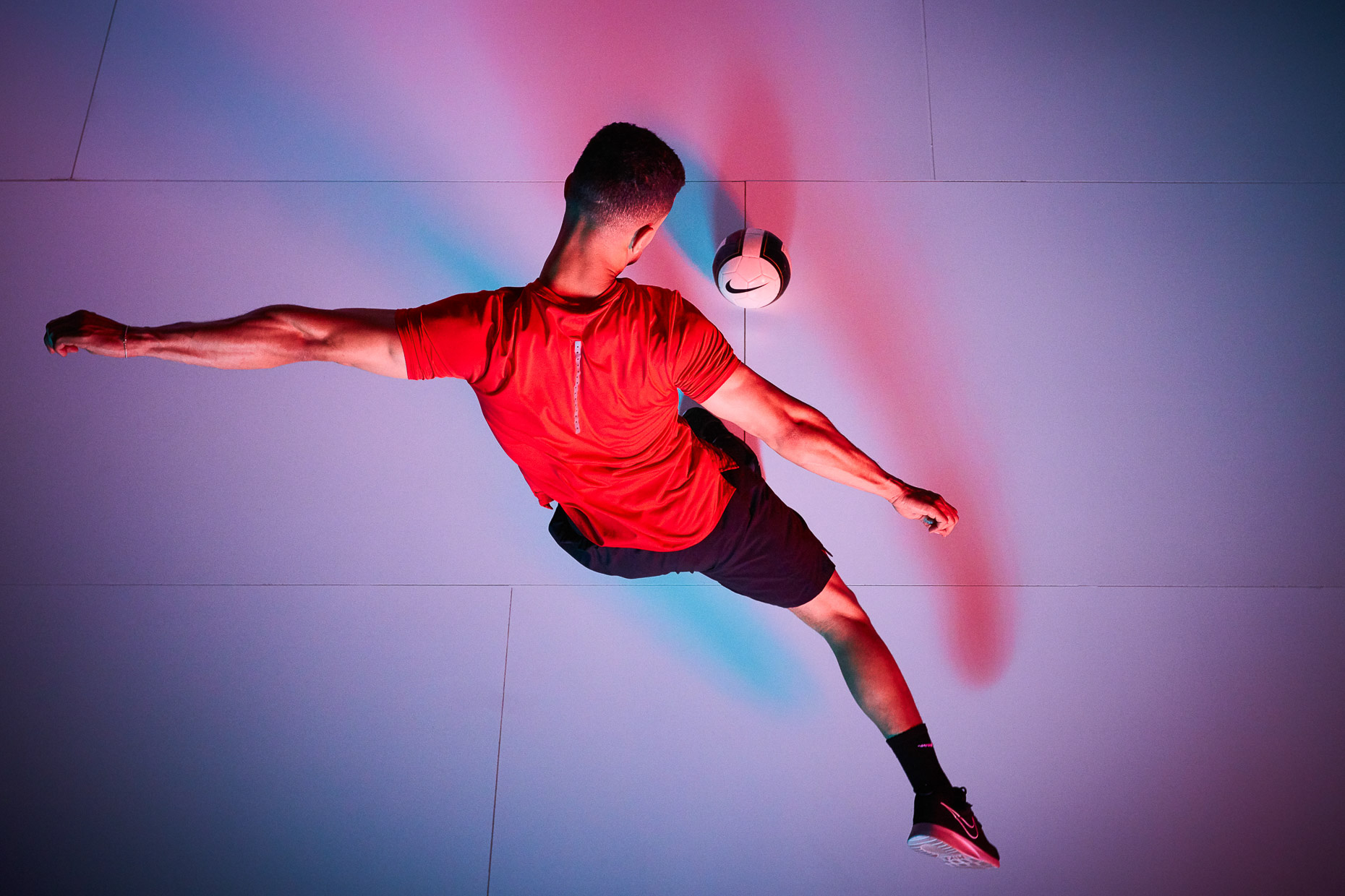 Nike Soccer futbol nike with Saif Alrikabi kicking the ball and shot from above with colorful blue and red gels by Andy Batt
