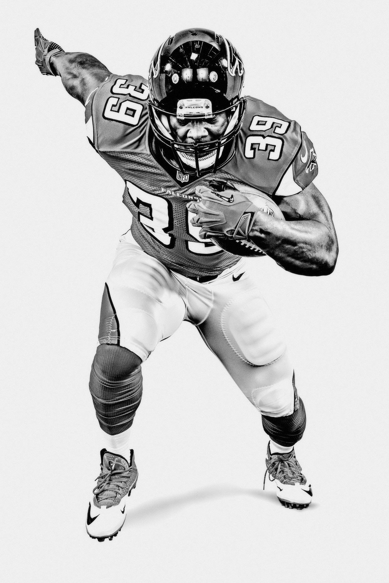 NFL Verizon Steven Jackson Atlanta Falcons running with football in a white studio b&w by Andy Batt