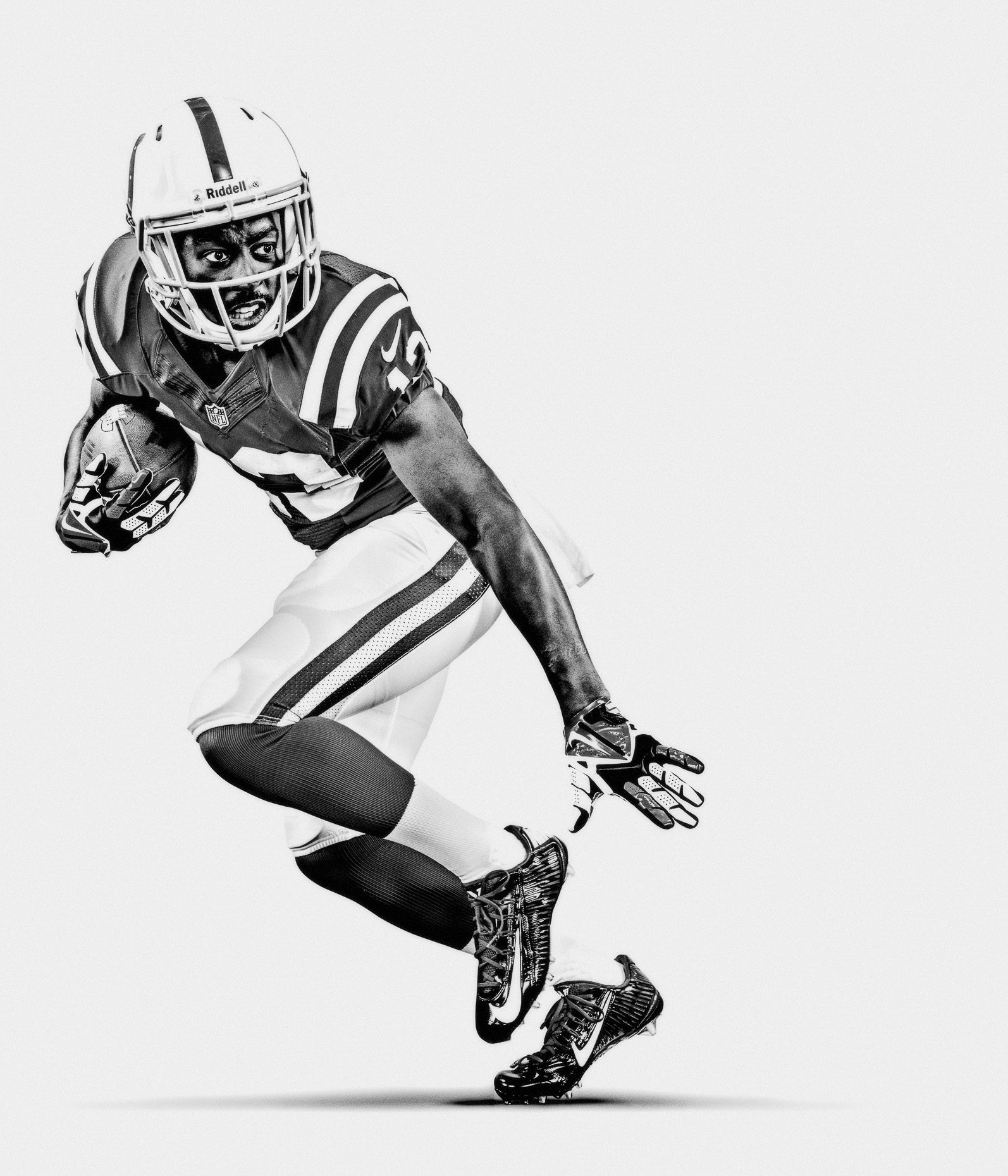 NFL Verizon Ty Hilton defends football for the Indianapolis Colts in a white studio b&w by Andy Batt
